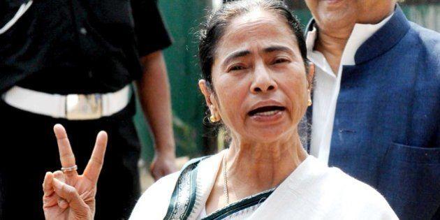 KOLKATA, INDIA - FEBRUARY 16: Chief Minister Mamata Banerjee flashes victory sign after winning the Bongaon...