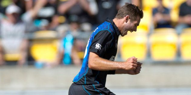 New Zealand's Tim Southee celebrates after taking his seventh wicket during their Cricket World Cup...