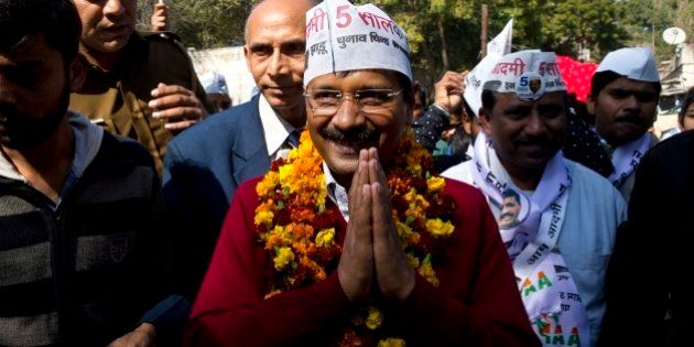Aam Aadmi Party, or Common Man Party, leader Arvind Kejriwal, center, campaigns ahead of Delhi state...