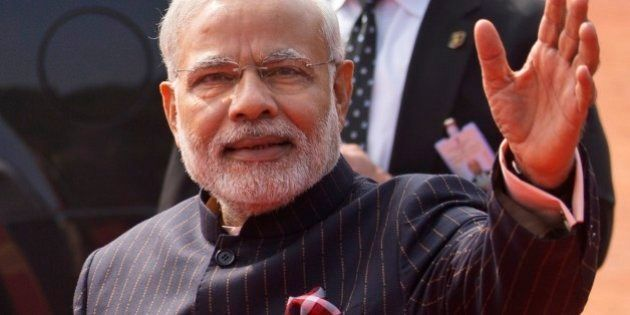 In this Jan.25, 2015 photo, Indian Prime Minister Narendra Modi wears a dark pinstriped suit with his...