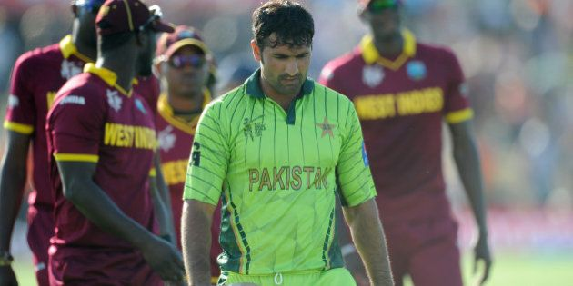 Pakistan's Sohail Khan walks from the field after they lost their Cricket World Cup match to the West...