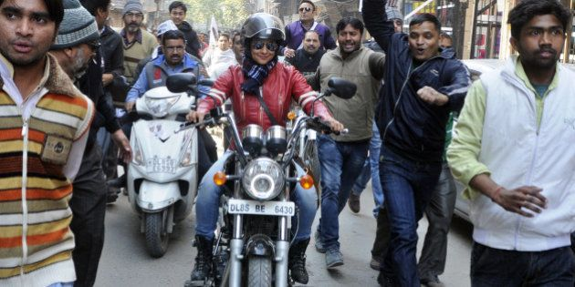 NEW DELHI, INDIA - JANUARY 29: Bollywood actress and AAP leader Gul Panag rides bike during election...