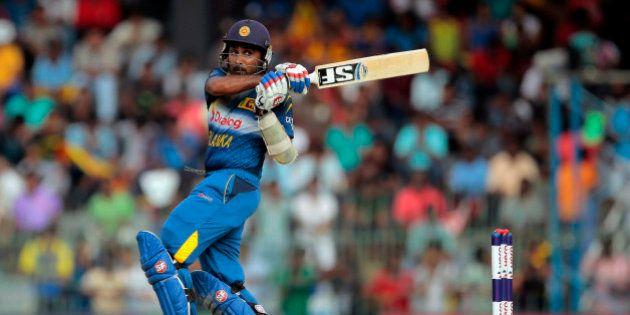 FILE- In this Sunday, Dec. 7, 2014 file photo, Sri Lankan batsman Mahela Jayawardene plays a shot during...
