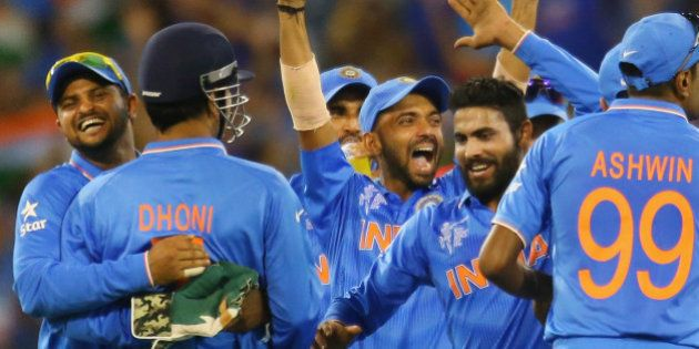 MELBOURNE, AUSTRALIA - FEBRUARY 22: MS Dhoni of India celebrates with his teammates after running out...