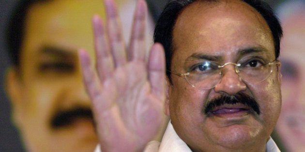 President of the Bharatiya Janata Party (BJP) Venkaiah Naidu gestures at a press conference in Bangalore,...