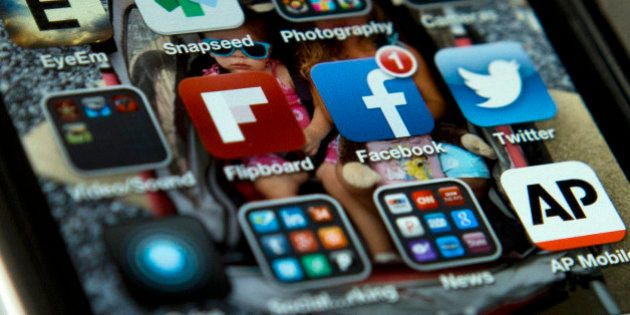 A view of an iPhone in Washington Tuesday, May 21, 2013, showing the Twitter and Facebook apps among...