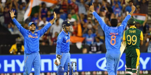 Indian player's Suresh Raina,left, M S Dhoni and Ravindra Jadeja, second right, celebrate as South Africa's...