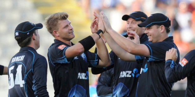 New Zealand's Corey Anderson, second from left, celebrates with teammates after dismissing India's...