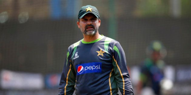 Pakistan cricket team coach Moin Khan gestures to players during a training session ahead of their ICC...