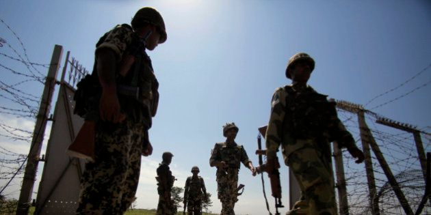 FILE - In this Monday, Sept. 16, 2013 file photo, India's Border Security Force (BSF) soldiers patrol...