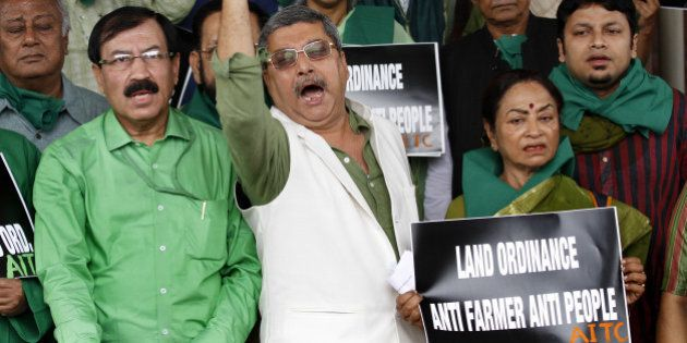 NEW DELHI, INDIA - FEBRUARY 24: Trinamool Congress MPs staged a protest against the Land Acquisition...