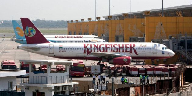 Kingfisher Airlines jets parked at the Indira Gandhi international airport in New Delhi, India, Tuesday,...