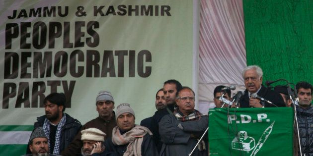 Peoples Democratic Party (PDP) leader Mufti Mohammad Sayeed, right, addresses an election campaign rally...