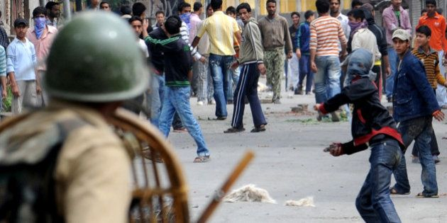 (FILES) In this photograph taken on June 12, 2010, Kashmiri protesters throw stones at Indian paramilitary...