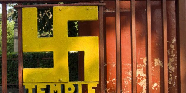 A swastika [in India the swastika as an important Hindu symbol that represents God (Brahman)], decorates...