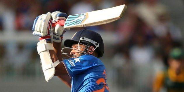 India's Ajinkya Rahane, plays a shot during their Cricket World Cup pool B match against South Africa...
