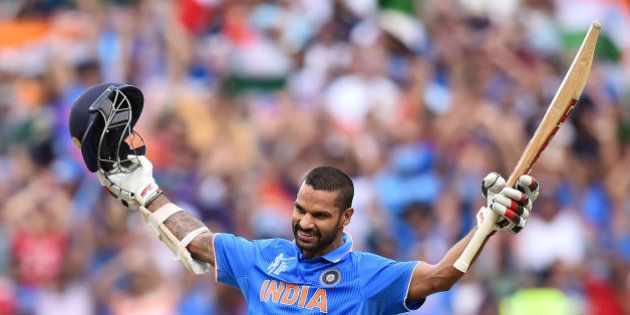 India's Shikhar Dhawan celebrates after scoring a century against South Africa during their Cricket World...