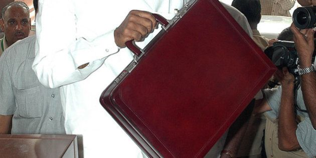 INDIA - JULY 08: Indian Finance Minister Palaniappan Chidambaram carries the briefcase containing his...