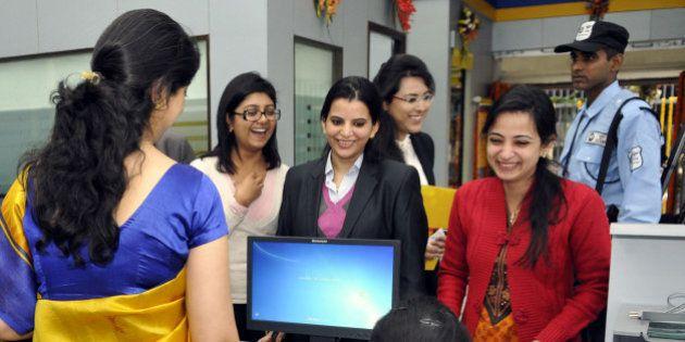 NEW DELHI, INDIA - DECEMBER 5: Women staff member working in first branch of Bharatiya Mahila Bank in...
