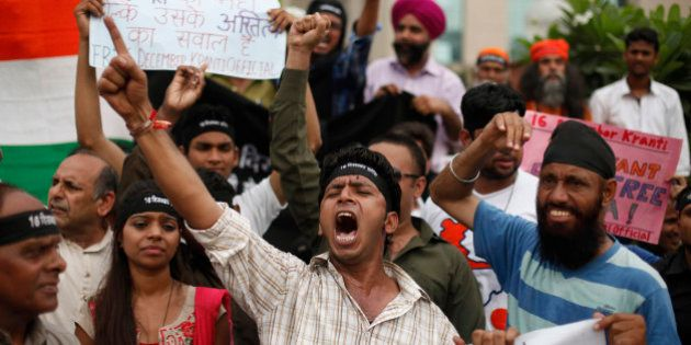 Indians shout slogans seeking death sentence for a juvenile convict who was earlier given a three-year...