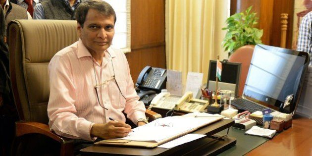 Indian Railway Minister Suresh Prabhu poses for the media while giving the final touches to the Railway...