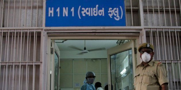 A security man stands outside an isolation ward for swine flu at the Civil Hospital in Ahmadabad, India,...