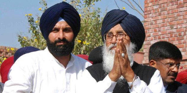 Punjab state Chief Minister and Shiromani Akali Dal (SAD) leader Parkash Singh Badal greets supporters...