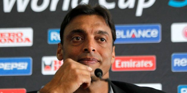 Pakistan's fast bowler Shoaib Akhtar attends a press conference as he announces his retirement from International...