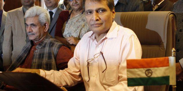 NEW DELHI, INDIA - FEBRUARY 25: Railway Minister Suresh Prabhakar Prabhu with MOS Manoj Sinha and their...