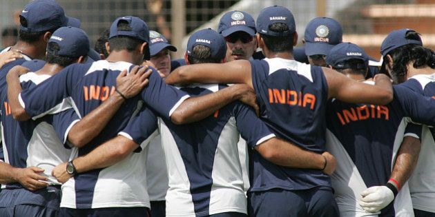 Indian cricket team manager Ravi Shastri, facing camera at center, speaks to team members at the Bir...