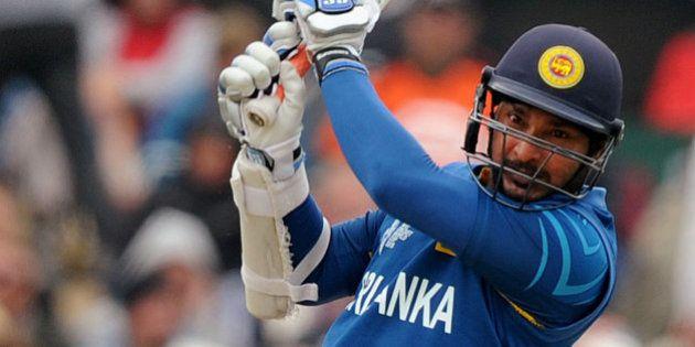 Sri Lanka's Kumar Sangakkara drives the ball against New Zealand during the opening match of the Cricket...