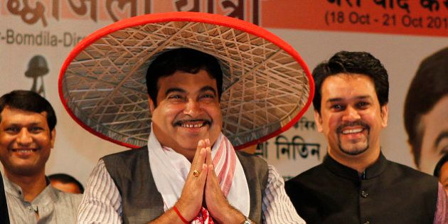 Bharatiya Janata Party (BJP) President Nitin Gadkari wears a traditional Assamese Japi and welcomes supporters...