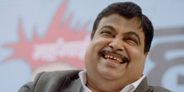 India's main opposition Bharatiya Janata Party president Nitin Gadkari laughs at a rally to protest against...