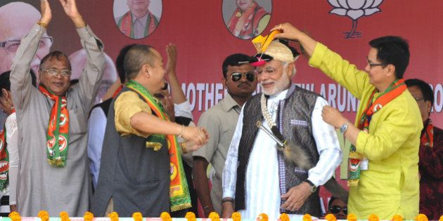 ITANAGAR, INDIA - MARCH 31: BJP Prime Ministerial candidate Narendra Modi welcomed by local leaders during...