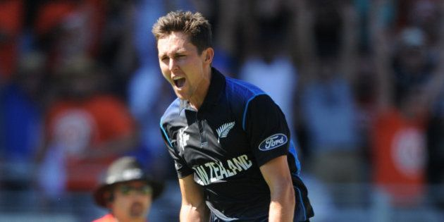 New Zealand's Trent Boult celebrates after taking the wicket of Australia's Mitchell Starc for no score...