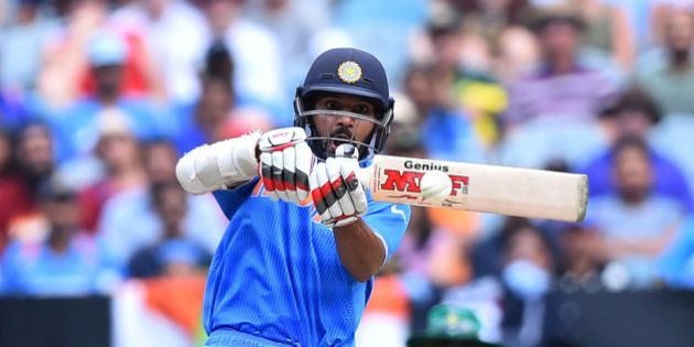 India's Shikhar Dhawan looks to play a pull shot during their Cricket World Cup pool B match against...