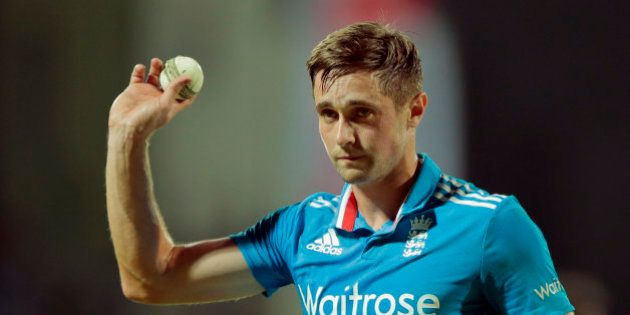 England's bowler Chris Woakes acknowledges the crowd after taking five Sri Lankan wickets during the...