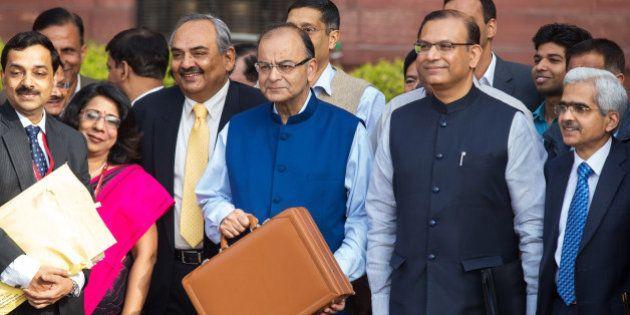 Arun Jaitley, India's finance minister, third right, Rajiv Mehrishi, finance secretary, third left, Jayant...