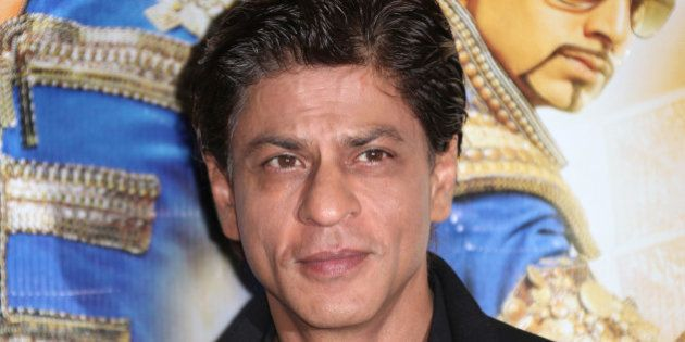 Actor Shah Rukh Khan poses for photographers during a photo call for the film, Happy New Year-SLAM, at...