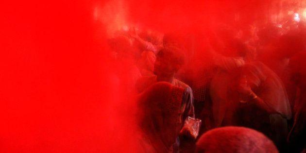 VRINDAVAN, INDIA - FEBRUARY 27: Hindu devotees smeared in colors during Lathmar Holi celebrations at...