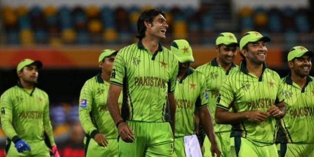Pakistan's players smile as they walk back after defeating Zimbabwe in the Pool B Cricket World Cup match...
