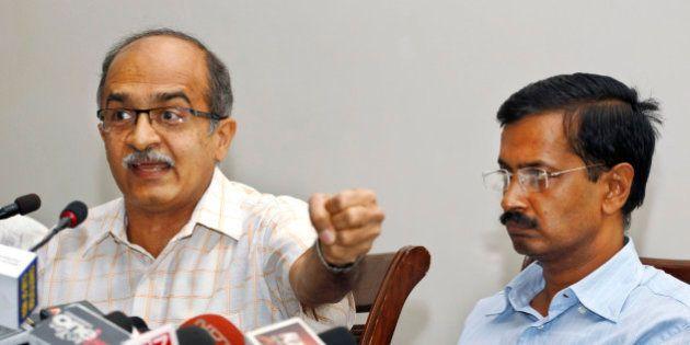 Prashant Bhushan, left, and Arvind Kejriwal, associates of Anna Hazare, India's most prominent anti-corruption...
