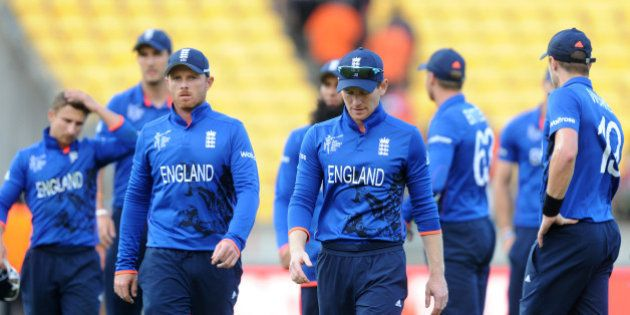 England's captain Eoin Morgan leads his player's from the field after they lost to Sri Lanka by nine...
