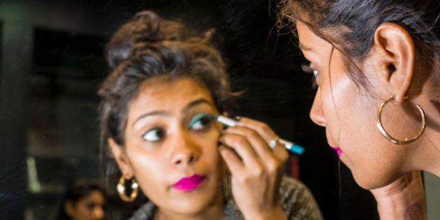 MUMBAI, MAHARASHTRA, INDIA - 2013/12/22: A portrait of a beautiful young Muslim woman putting make-up...