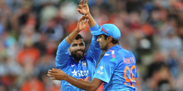India's Ravindra Jadeja, left, celebrates with India's Ravi Ashwin after running out New Zealand's...