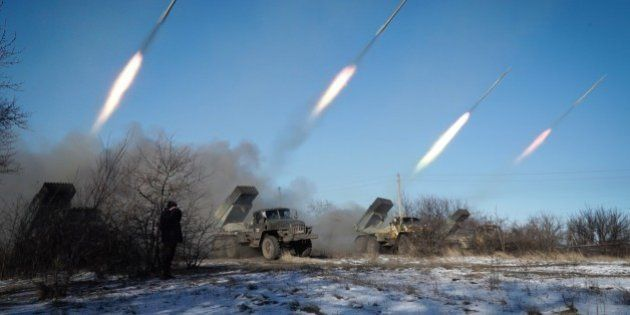 Pro-Russian rebels stationed in the eastern Ukrainian city of Gorlivka, Donetsk region, launch rockets...