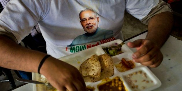 A supporter wears a t-shirt with a portrait of Bharatiya Janata Party (BJP) leader and India's next...