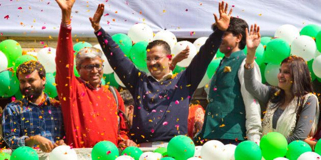 Leader of the Aam Aadmi Party, or Common Man's Party, Arvind Kejriwal, center, waves to the crowd as...
