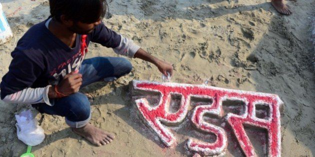 ALLAHABAD, INDIA - 2014/11/30: Allahabad University students make a sand sculpture on the eve of 'World...