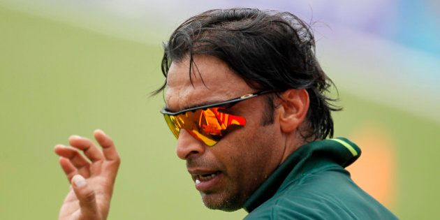 Pakistani fast bowler Shoaib Akhtar gestures during a practice session ahead of their ICC Cricket World...